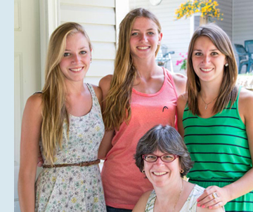 Photo of Nancy and her three daughters.