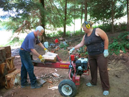 Photo of log splitter and crew.