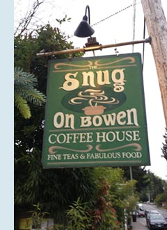 Photo of the outdoor sign for the Snug Coffee Shop.